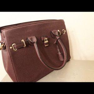 Top handle Handbag with lock.